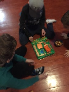 Kids playing Run Yourself Ragged Screwball Scramble on floor