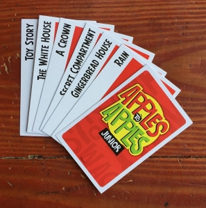 Red apple cards from Apples to Apples Junior card game fanned out