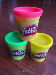 Medium containers of Play-Doh modeling dough compound stacked in pyramid