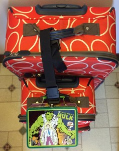 Samsonite Add-a-Bag luggage strap with roller board and lunch box attached to full size Orla Kiely orange stem pattern suitcase