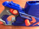 Nerf Nitro Car Blaster launcher close up view of trigger blue orange and gray plastic