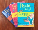 Roald Dahl books for kids The BFG Matilda and The Witches in fanned stack on hardwood floor