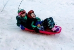 Kids wearing Champion snow clothes bib jacket pants from Target sledding