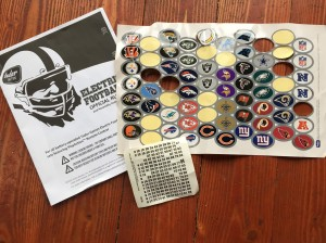 Player number stickers and NFL football team logos from NFL Electric Football game