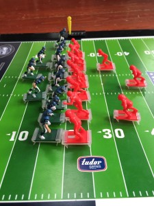 Two teams lined up on the 20 yard line in NFL Electric Football game