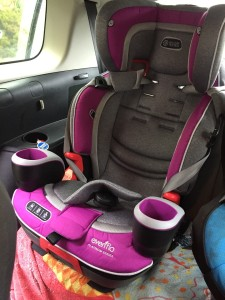 Evenflo Evolve platinum 3-in-1 combination booster seat installed in third row of Mazda 5 minivan