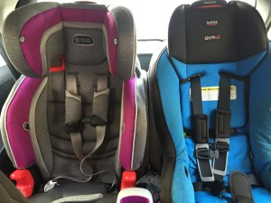Evenflo Evolve 3 in 1 booster car seat next to Britax Marathon convertible car seat in back third row of Mazda5