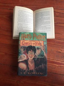 Harry Potter page excerpt held open by Harry Potter and the Goblet of Fire