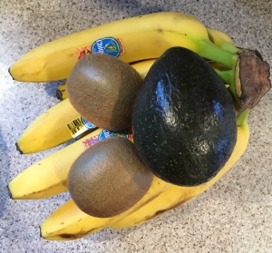 Bananas, avocados, and kiwis on counter
