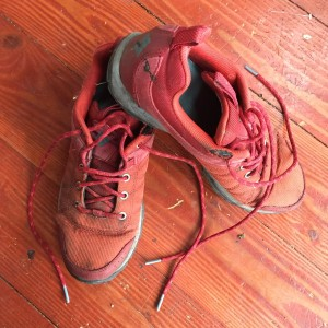 Well worn Columbia running shoes sneakers tennis shoes on hardwood floor