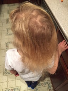 Child's blond hair brushed with no tangles