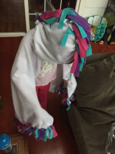 Girl wearing Unicorn Hoodie made from Make It Real kit