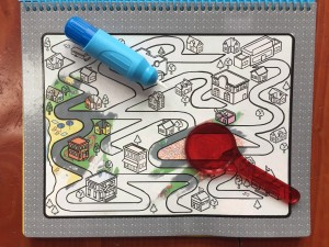 Melissa and Doug Water Wow Deluxe Around the Town with red lens and water pen on page