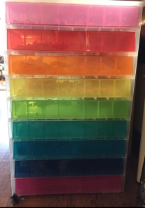 Nine Rainbow drawer storage unit filled with Lego pieces