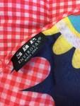 Envirosax Slingsax Messenger Bag label close up on pocket of reusable packable compact shopping bag