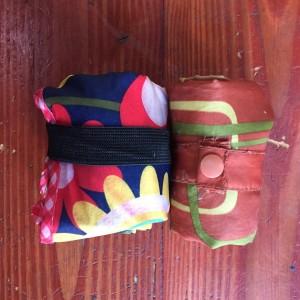 Envirosax Slingasx rolled up next to original Envirosax reusable portable shopping bag
