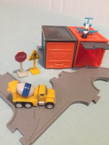 Driven Pocket Series 2 tiny trucks vehicles with garage in gray and orange and six connected road pieces
