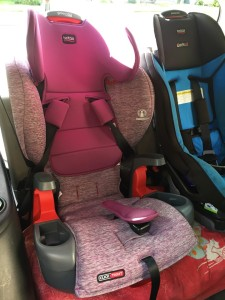 Brtiax Grow with You Harness2Booster seat next to Britax Marathon convertible car seat in third row of Mazda5