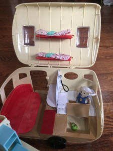 Calico Critters Caravan Family Camper shown partially open with beds folded out and trap door open