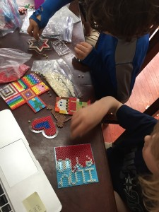 Kids at table working on fuse Perle melty bead projects
