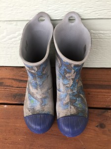 Crocs Bump It Rain boots in blue shark pattern worn off in places
