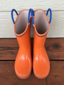 Norty Rain boots for kids in orange print with bright blue trim and handles