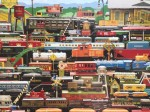 Train puzzle box lid photo with engines tanker cars, caboose, station and more