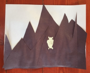 Hamster photographer on mountain backdrop art project by seven year old girl