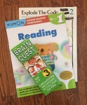Brain Quest question deck Grade 3 ages 8-9, Kumon First Grade level reading workbook, and Explode the Code level 2