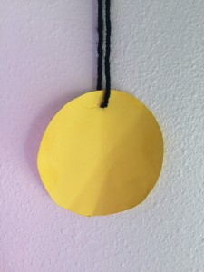 Child's medallion made from construction paper on string