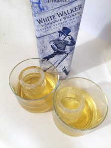 White Walker Johnny Walker whiskey bottle with two glasses partially filled