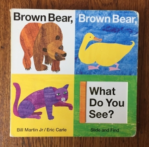 Brown Bear, Brown Bear, What Do You See? board book with sliding flaps by Bill Martin Jr illustrated byEric Carle