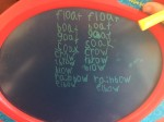 Boogie drawing board with second grade spelling words written twice on it by seven year old