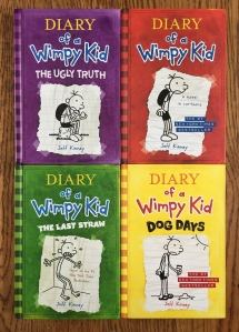 Diary of a Wimpy Kid by Jeff Kinley original book in series with red cover, The Ugly Truth purple cover, The Last Straw green cover, Dog Days yellow cover