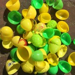 Plastic green and yellow color sorted Easter eggs open emptied on ground