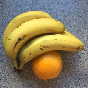 Bananas and oranges on counter