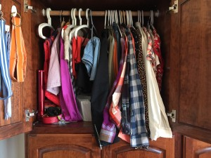 Wardrobe closet hanging space overflowing with clothes hanging too low long