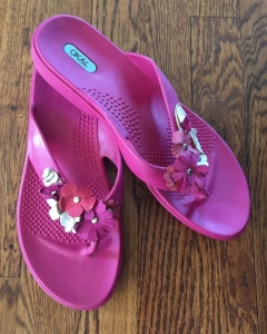 Oka B hot pink flip flop sandals with pink and white flowers on straps