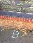 Letter B made from sidewalk chalk drawn on sidewalk