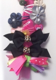 child's hair clip barrettes hanging stored on sheer pink ribbon