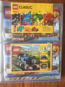 Lego Classic instruction manuals inside photo page protectors of three ring binders