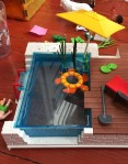 Playmobil City Life Pool with Terrace set up and filled with water with turtle float and umbrella