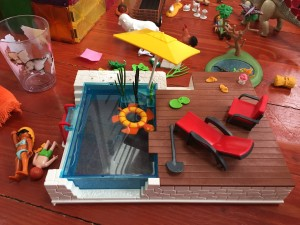 Playmobil City Life Pool with Terrace set up with turtle float yellow umbrella and red lounger and chair poolside deck