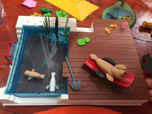 Playmobil City Life Pool with Terrace and seal family set swimming and sitting on lounge chair