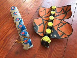 Caterpillar and butterfly made from egg cartons kid art project