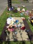 Yard sale for free sidewalk stuffed animals clothes and more set out for the taking