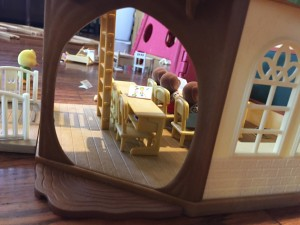 Doorway opening into Calico Critter Country Tree School with bears seated in first row of desks