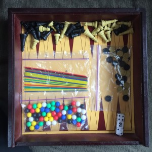 Backgammon board printed on bottom of storage box with pieces on top