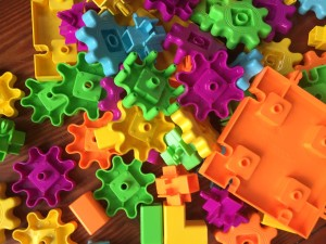 Gears! Gears! Gears! Pet Playland set gear pieces in orange, yellow, green, pink, and light blue from Learning Resources
