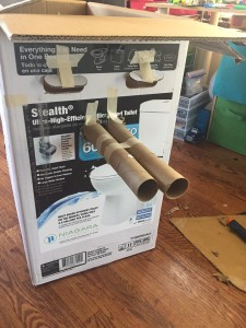 Tank made by kids art project from cardboard box and toilet paper tubes connected together